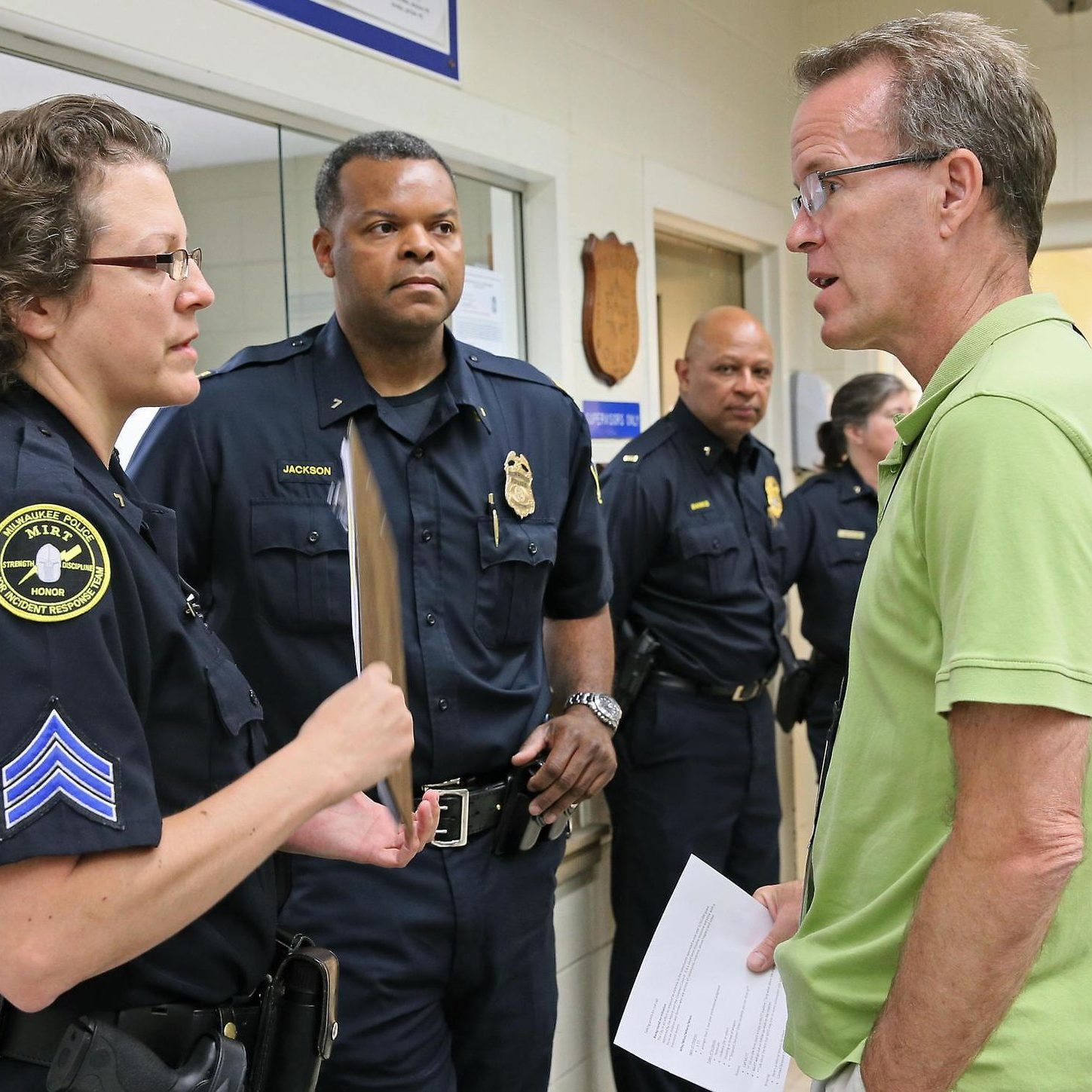 Mental Health Police Officer Meeting with Mental Health Workers during disaster